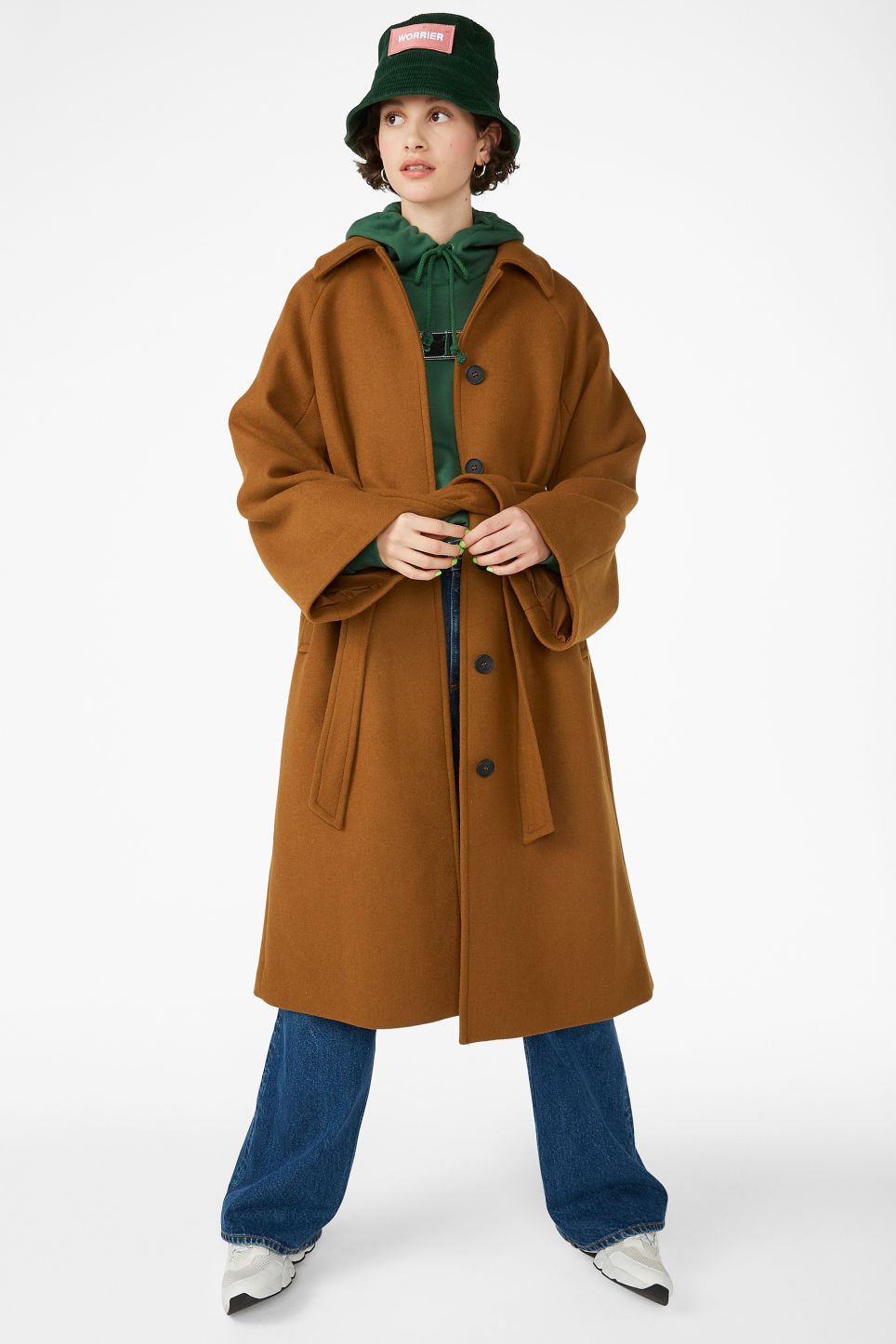 Model front image of Monki belted long coat in beige