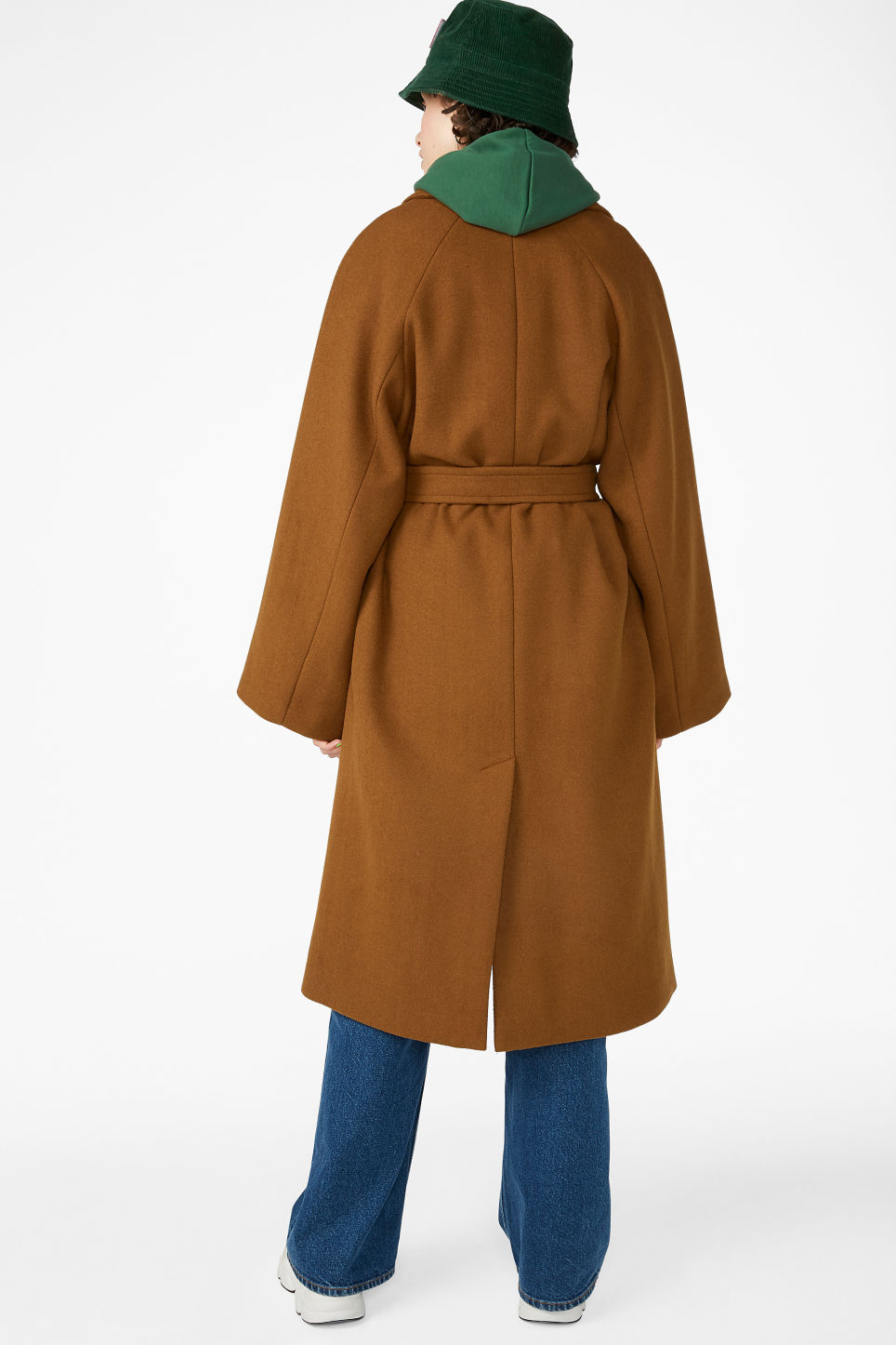 Model back image of Monki belted long coat in beige