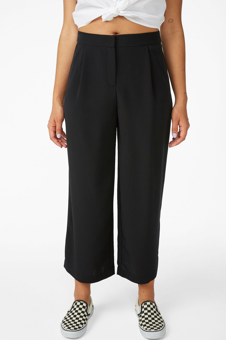 Model side image of Monki classic culottes in black