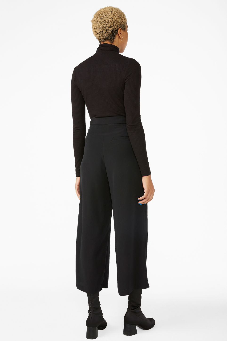 Model back image of Monki wide leg trousers in black