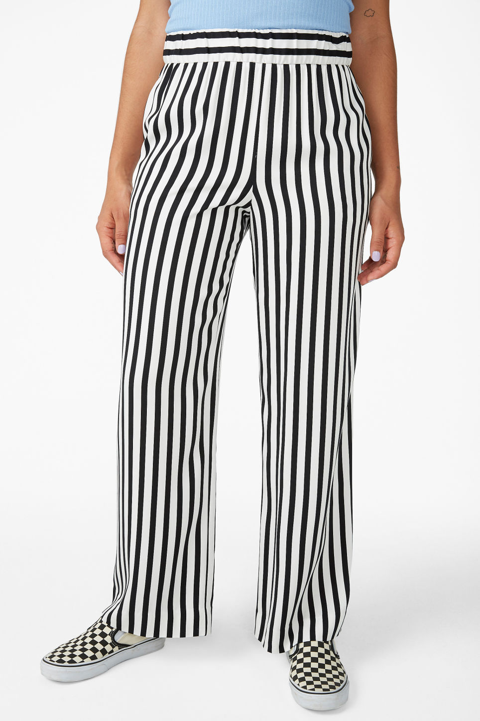 Model side image of Monki wide and straight trousers  in black