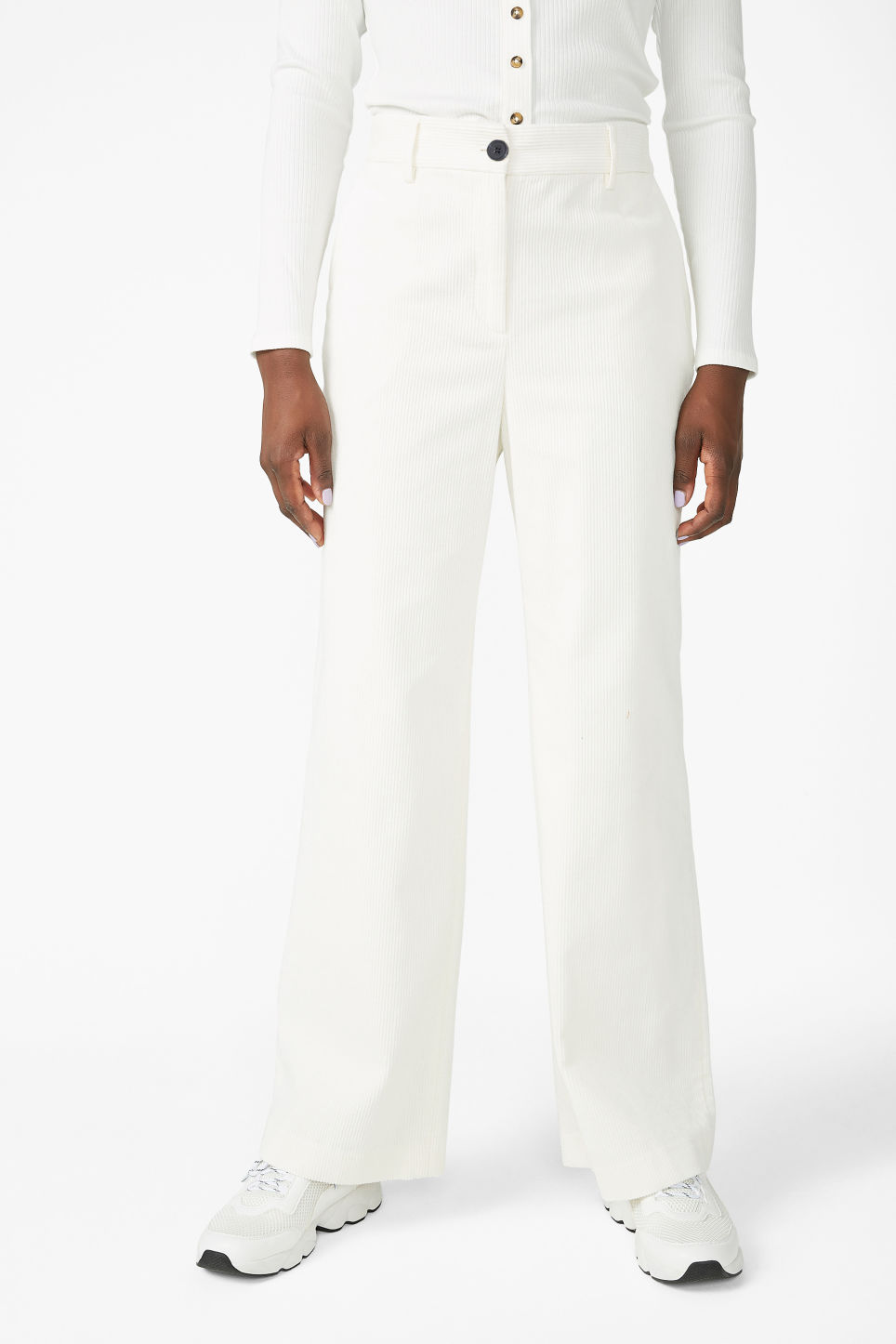 Model side image of Monki corduroy trousers in white