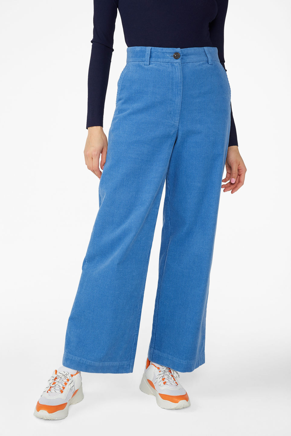 Model side image of Monki wide leg corduroy trousers in blue