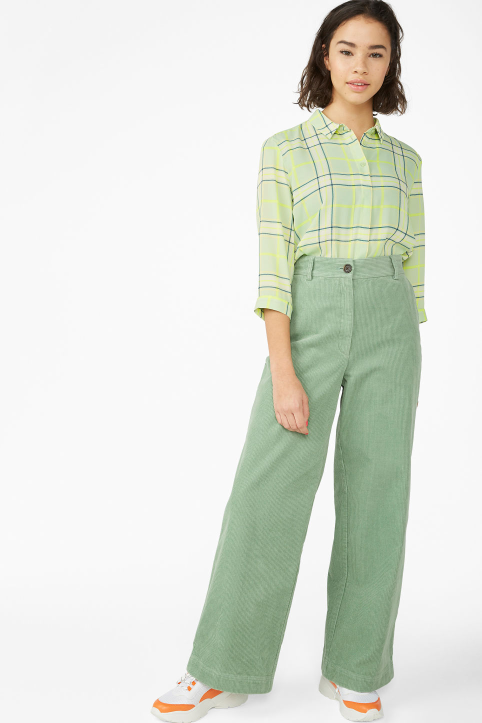Model front image of Monki corduroy trousers in green