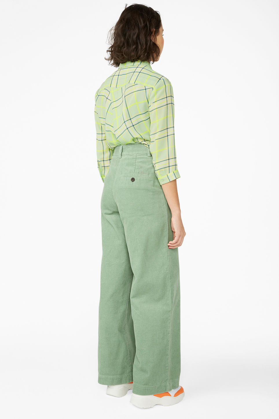 Model back image of Monki corduroy trousers in green