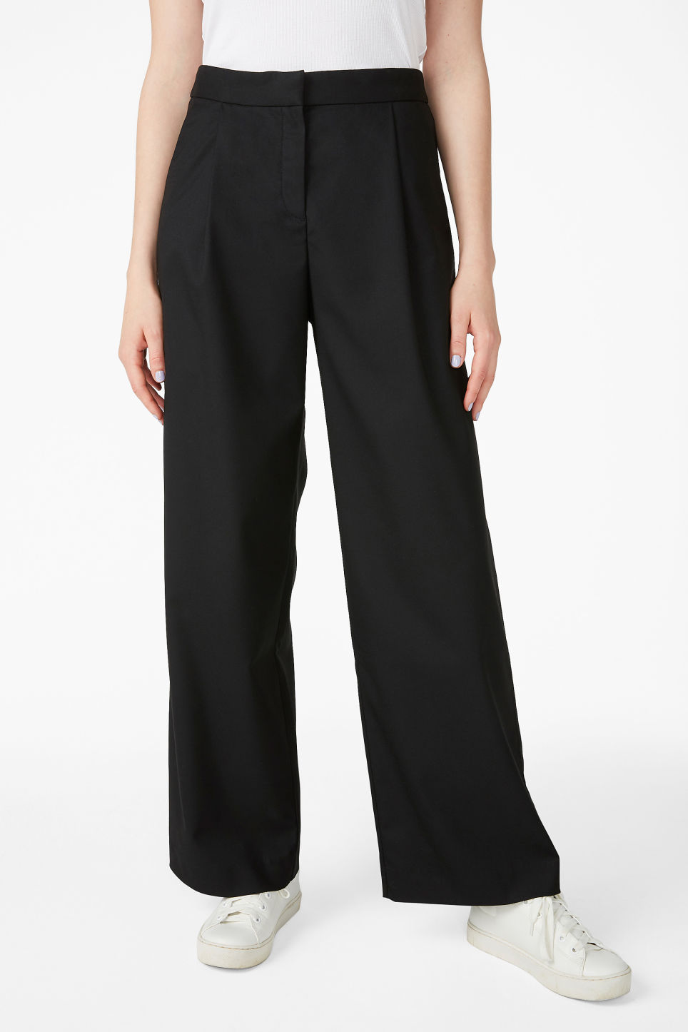 Model side image of Monki long wide trousers in black
