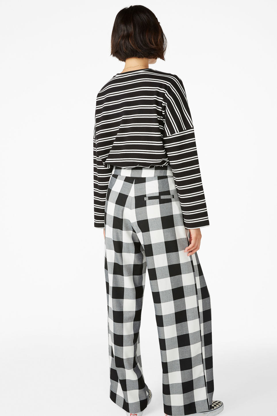 Model back image of Monki long wide trousers in black