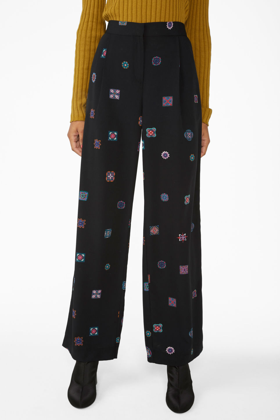 Model side image of Monki high waisted trousers in black