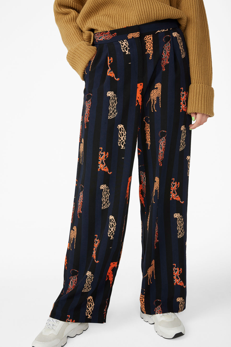 Model side image of Monki high waisted trousers in blue