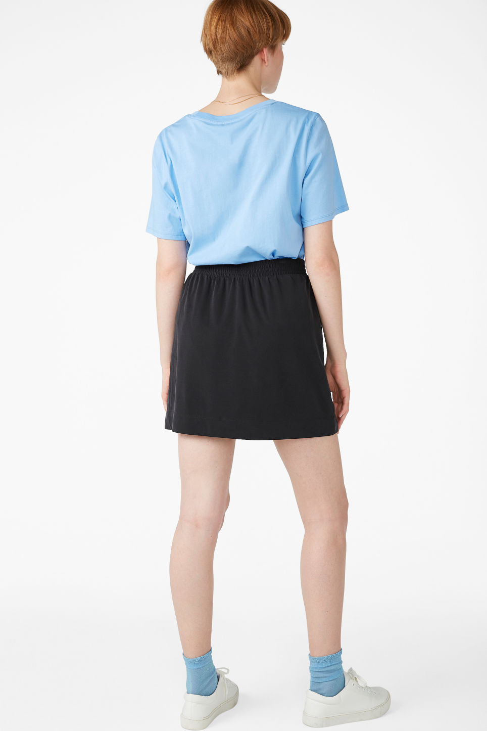Model back image of Monki super-soft micro wrap skirt in black