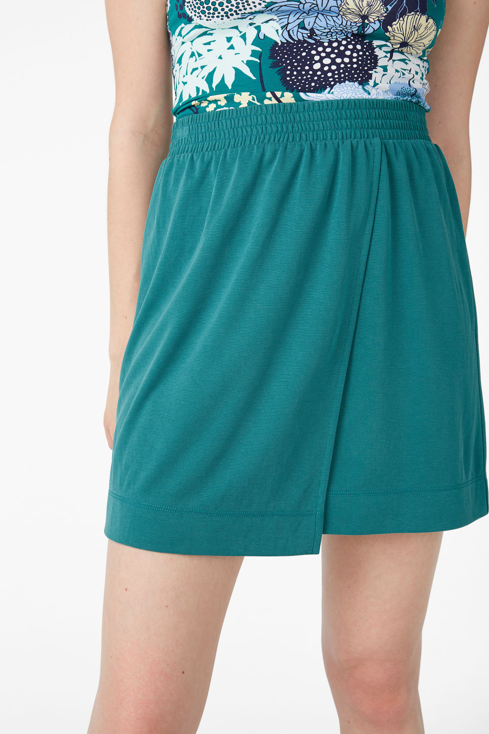 Model side image of Monki super-soft micro wrap skirt in green
