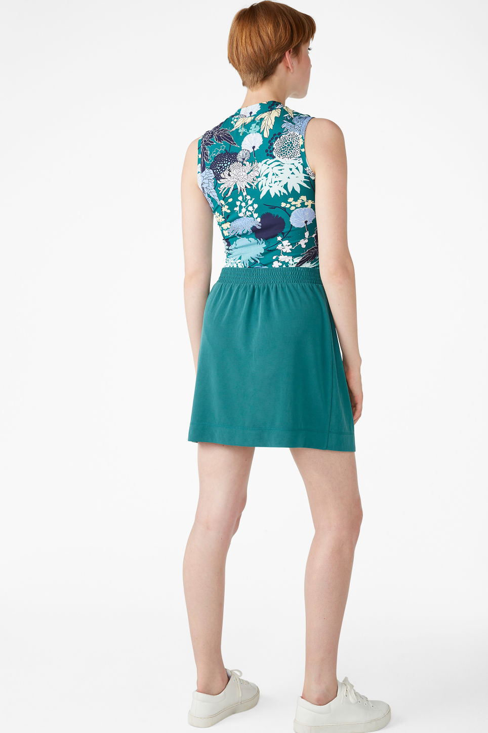 Model back image of Monki super-soft micro wrap skirt in green