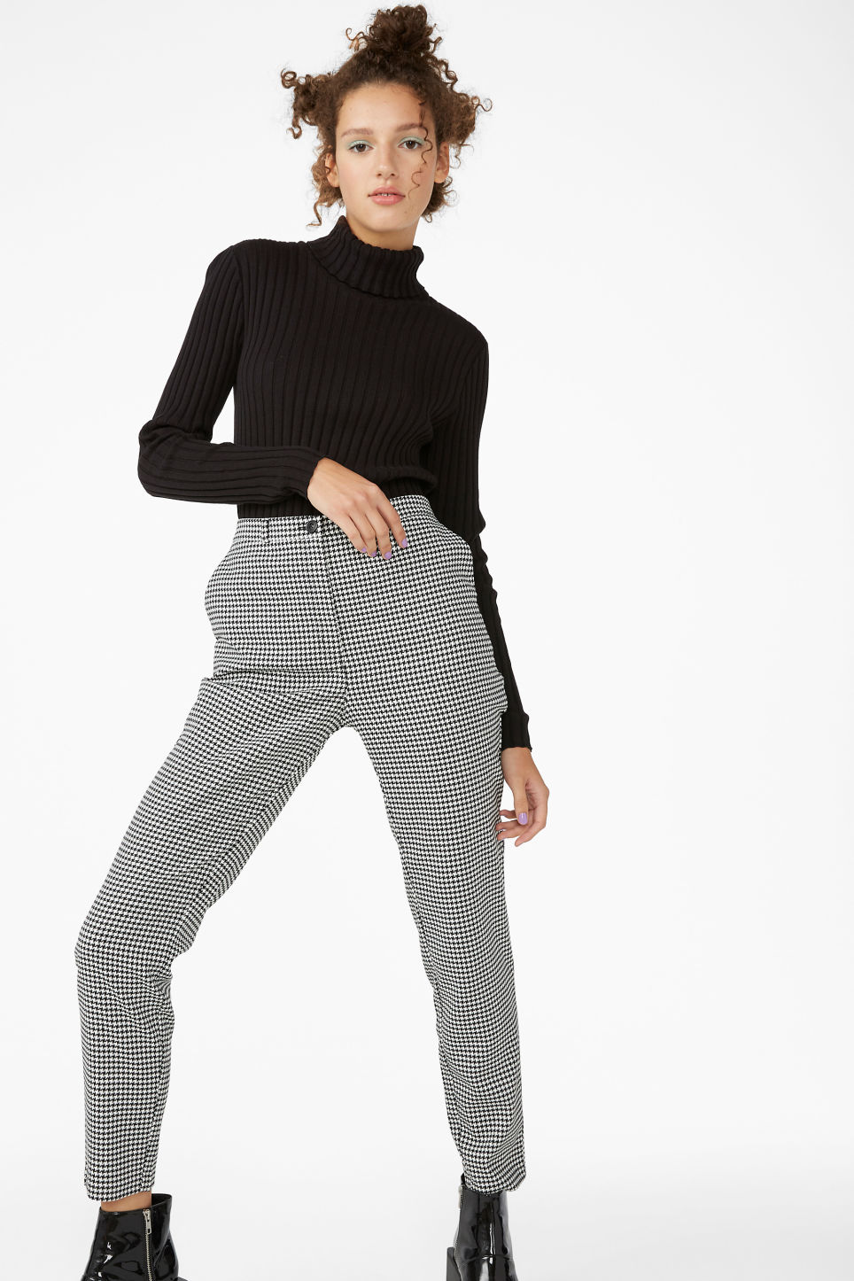 Model side image of Monki ribbed turtleneck in black