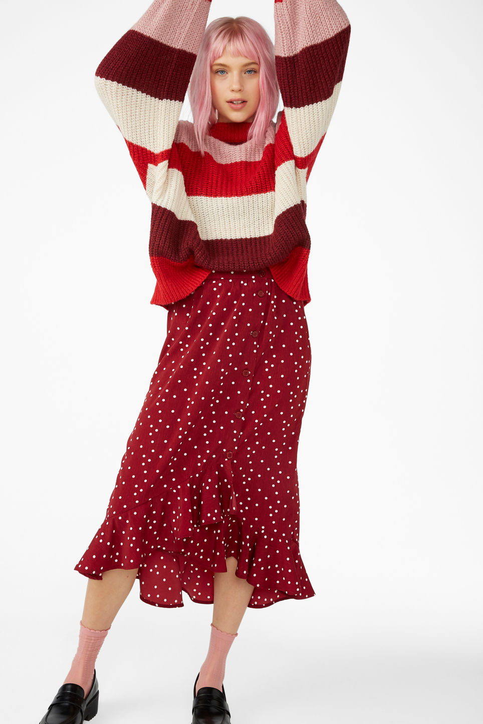 Model side image of Monki knit sweater in red