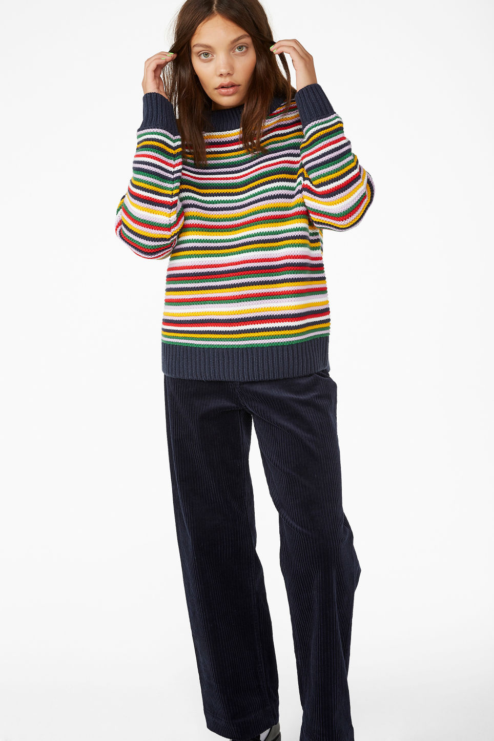 Model side image of Monki striped knit sweater in red