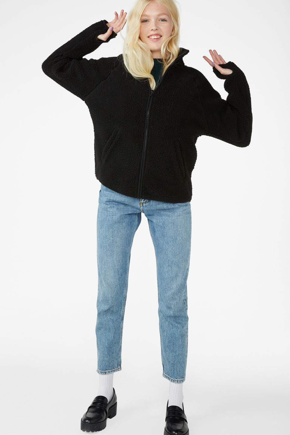 Model front image of Monki zip fleece sweater in black