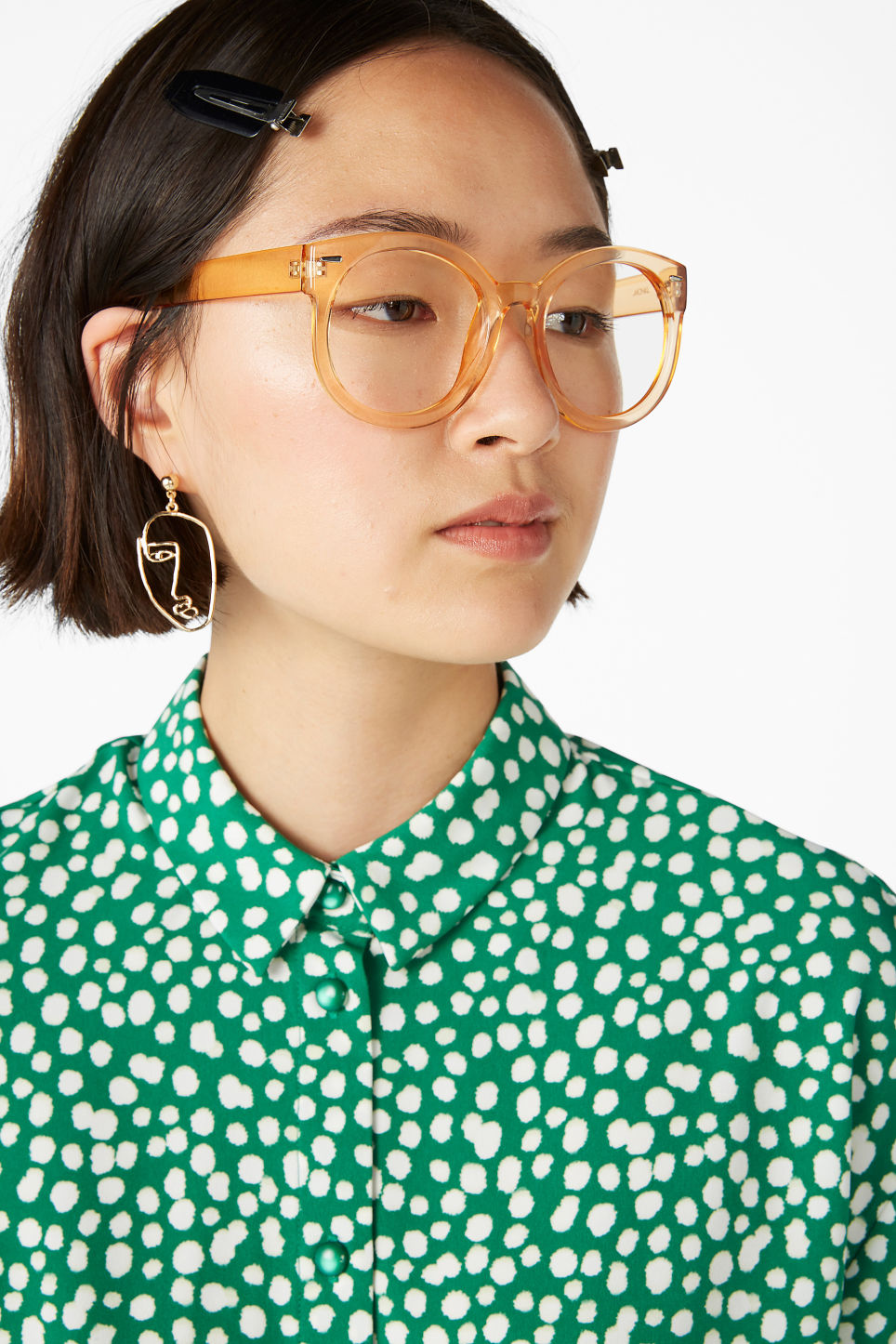 Model front image of Monki face earrings in gold