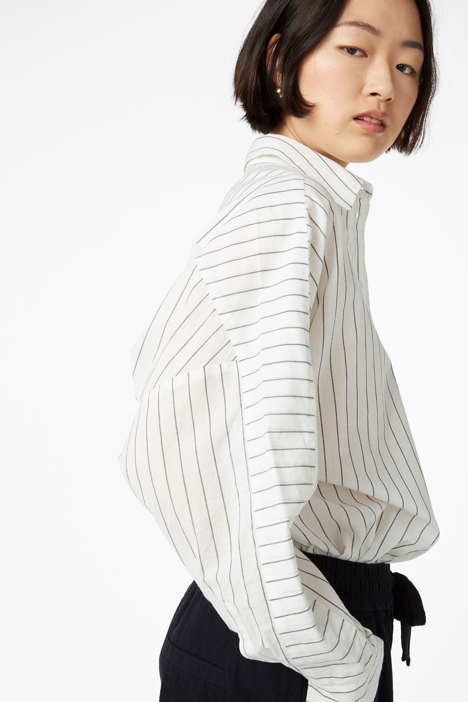 Model front image of Monki oversized blouse in white