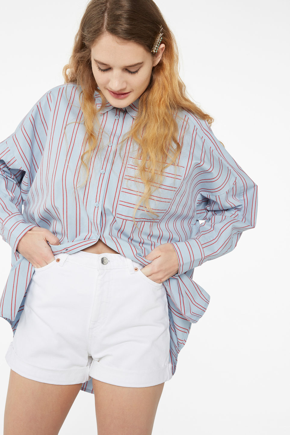 Model side image of Monki oversized button-up blouse in blue