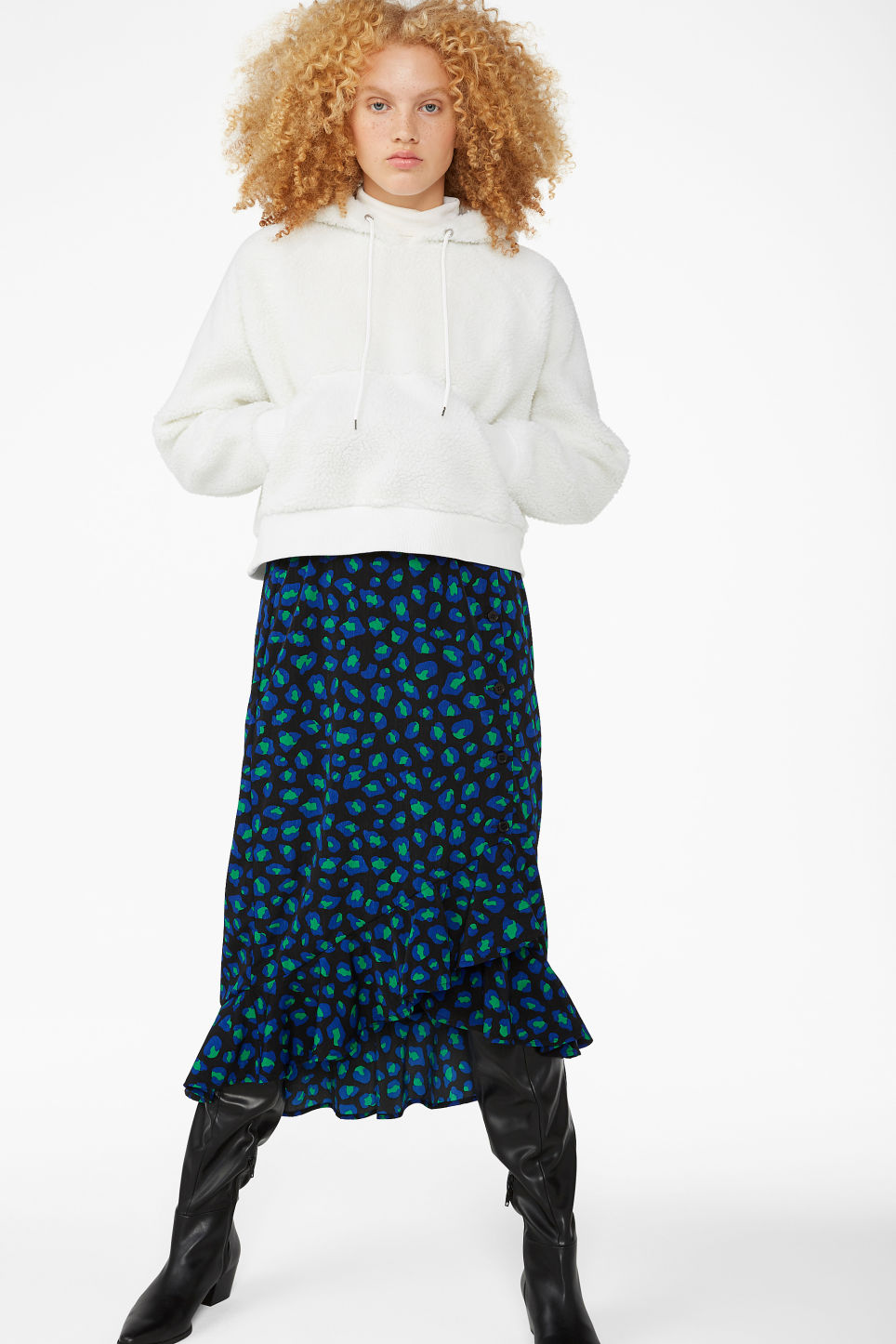 Model side image of Monki cropped hoodie in white