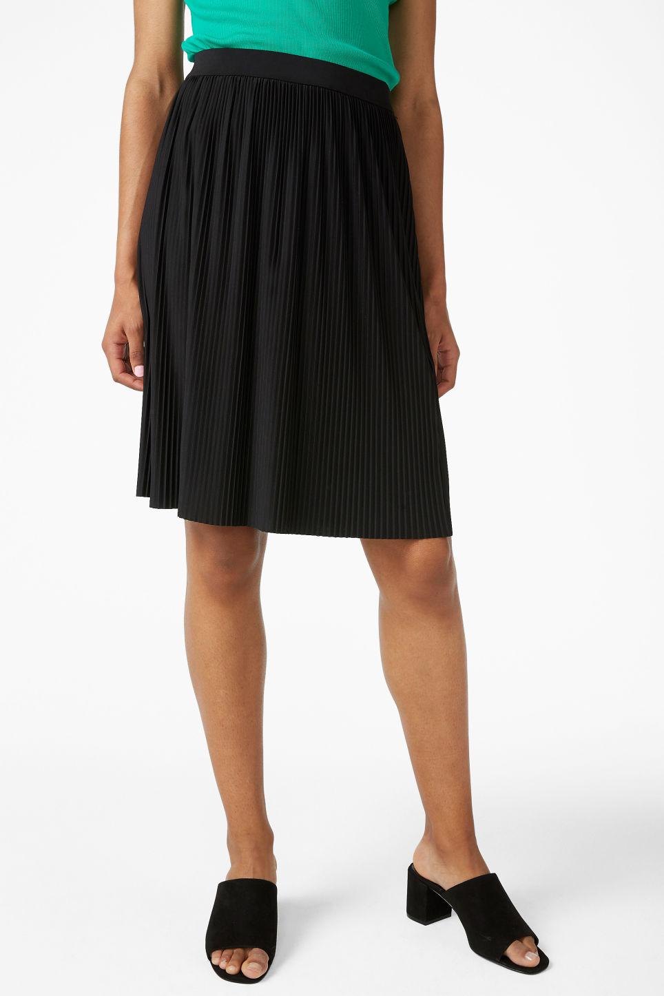 Model side image of Monki pleated mini skirt in black