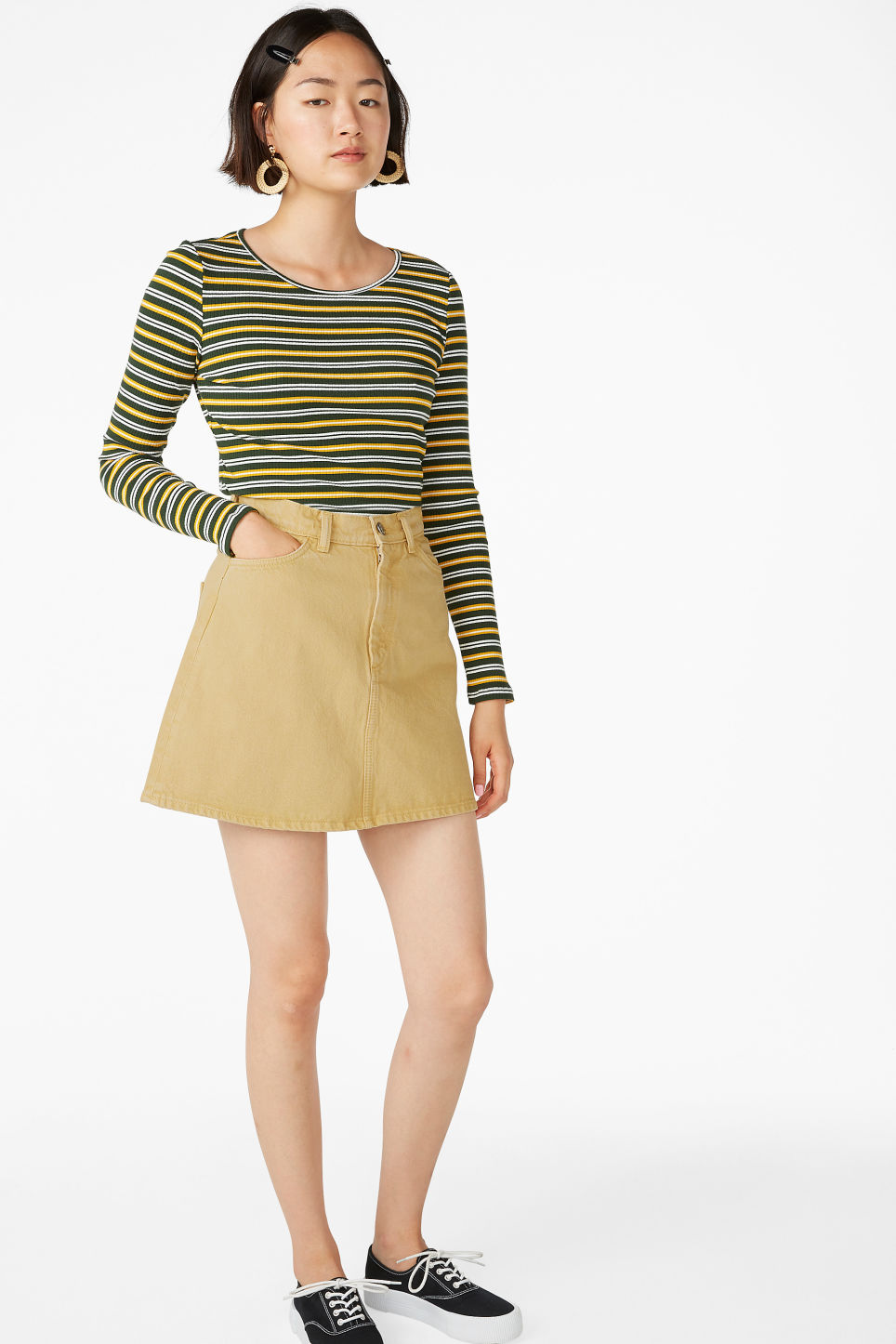 Model side image of Monki long-sleeved top in green