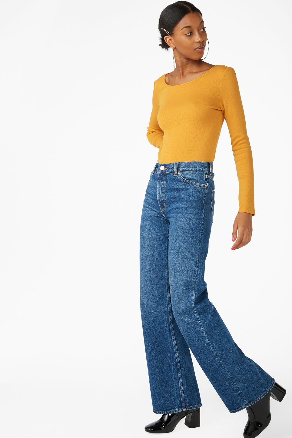 Model side image of Monki long-sleeved top in yellow