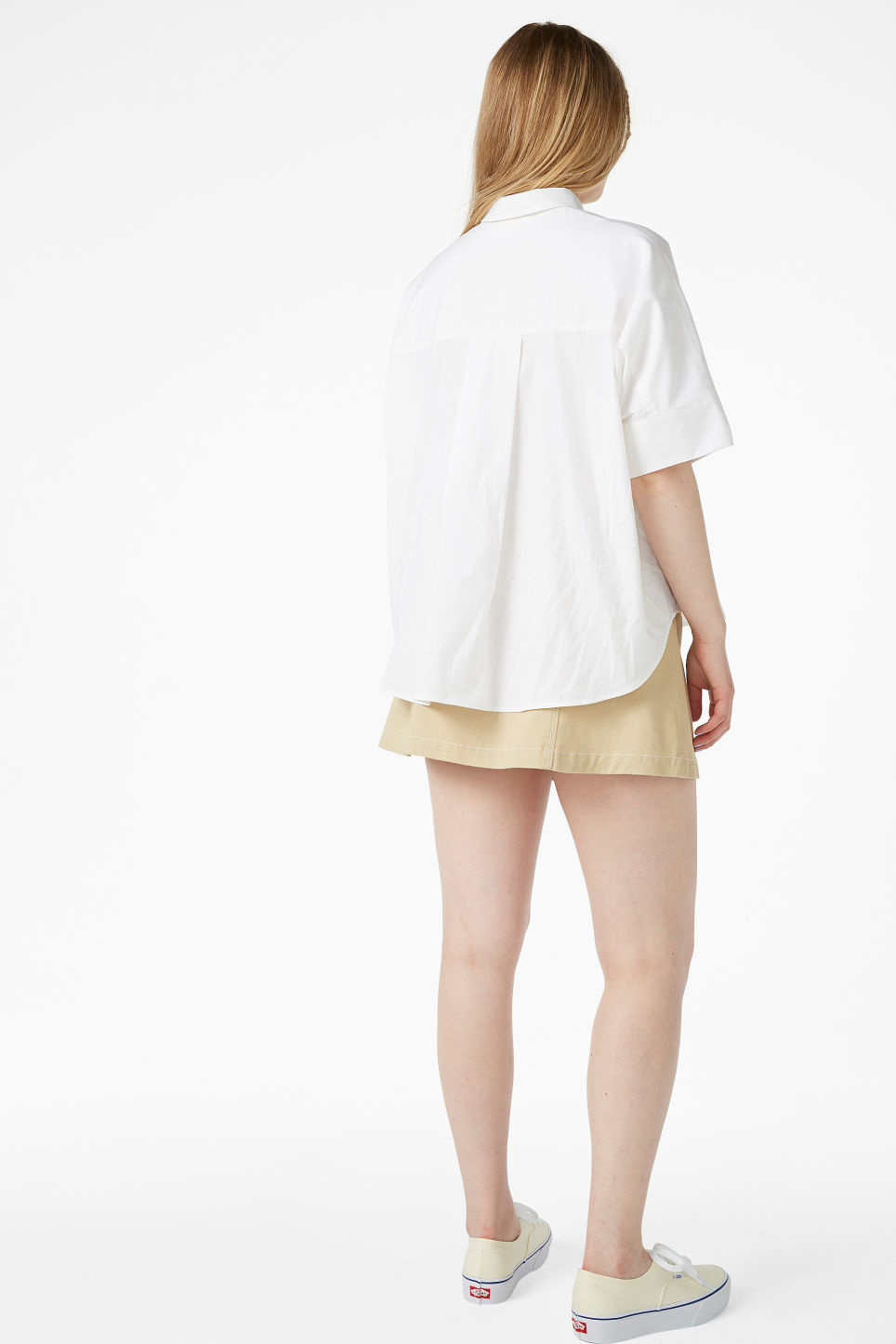 Model back image of Monki oversized hidden button blouse in white