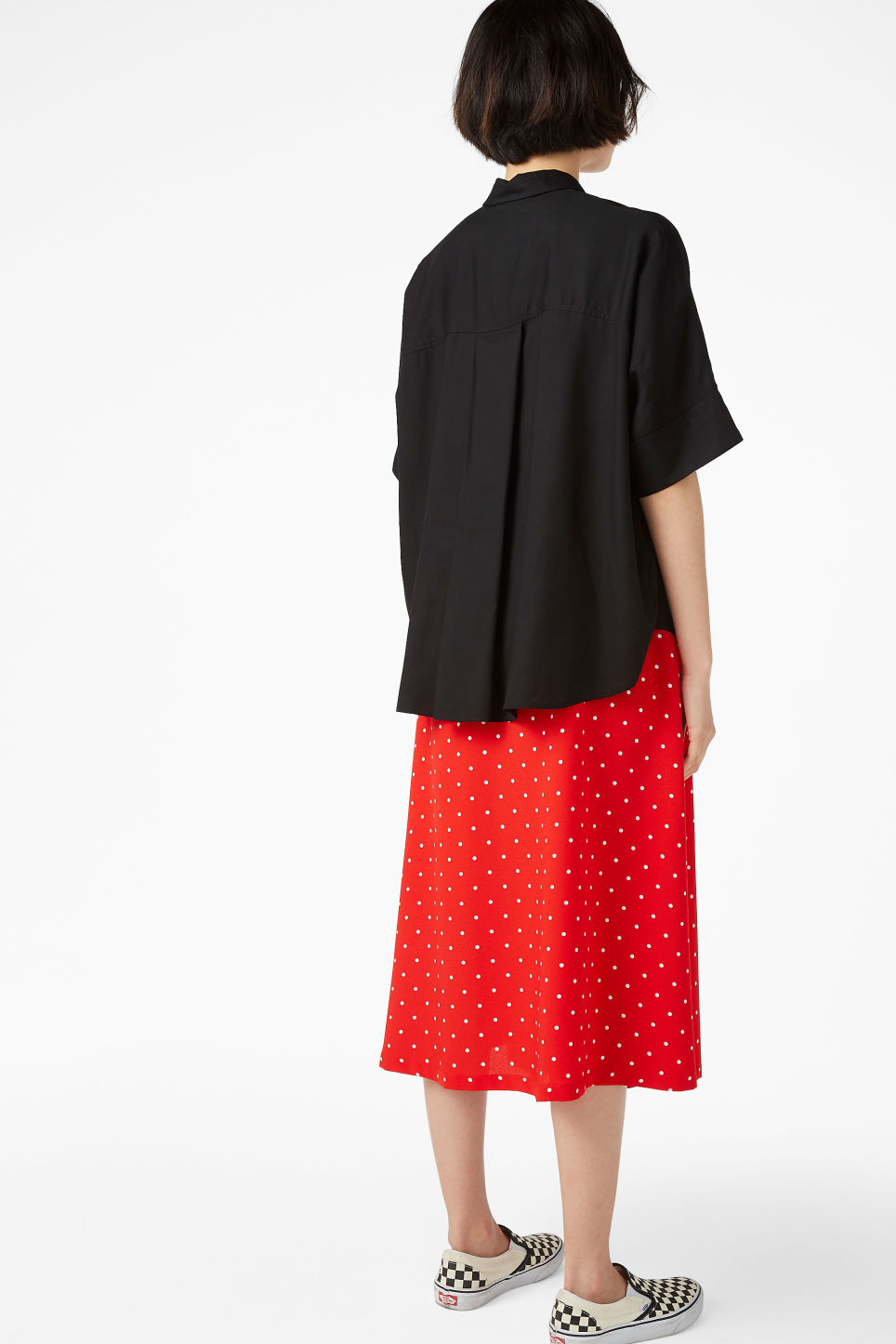 Model back image of Monki oversized hidden button blouse in black