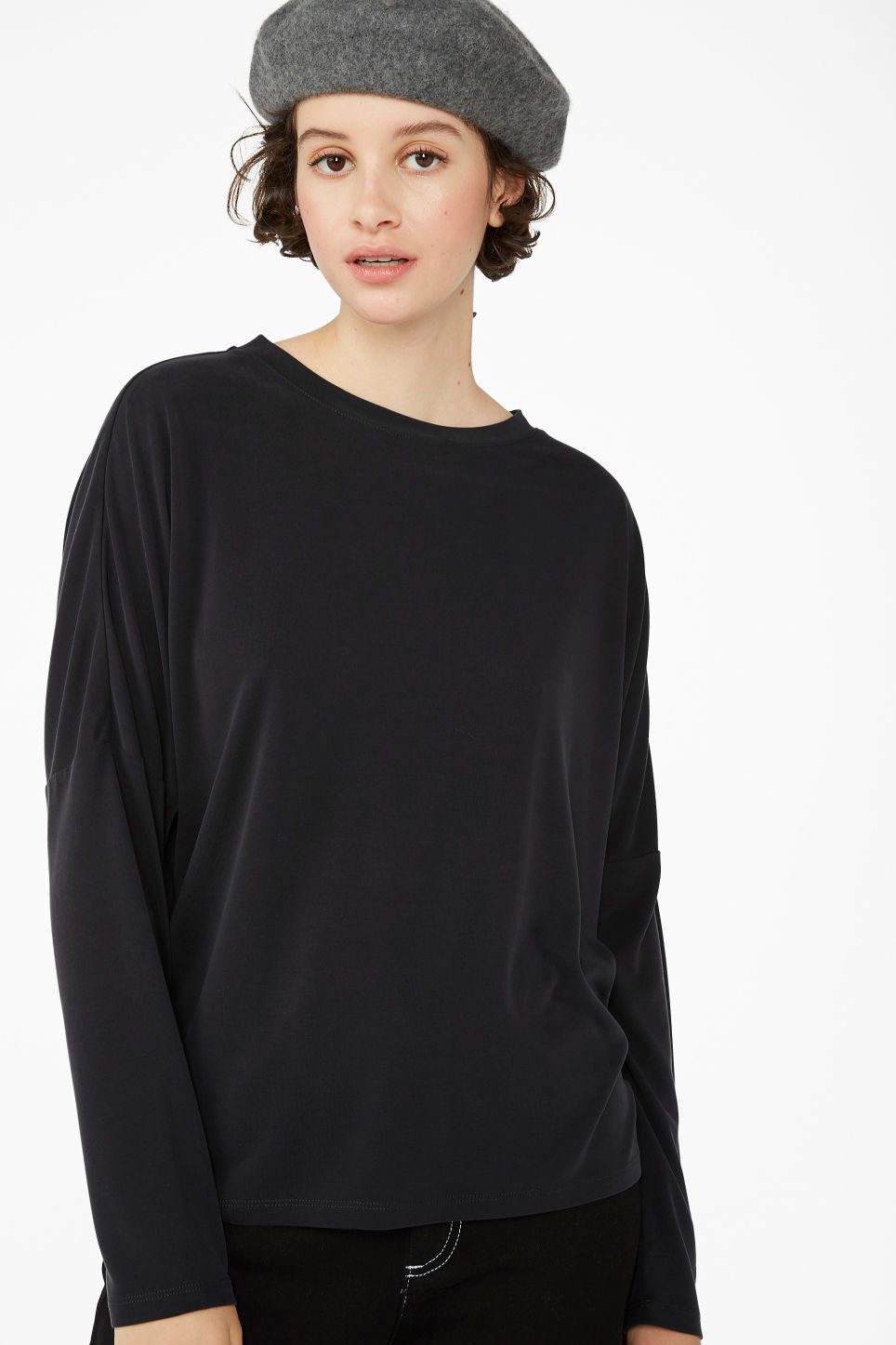 Model front image of Monki super-soft flowy top in black