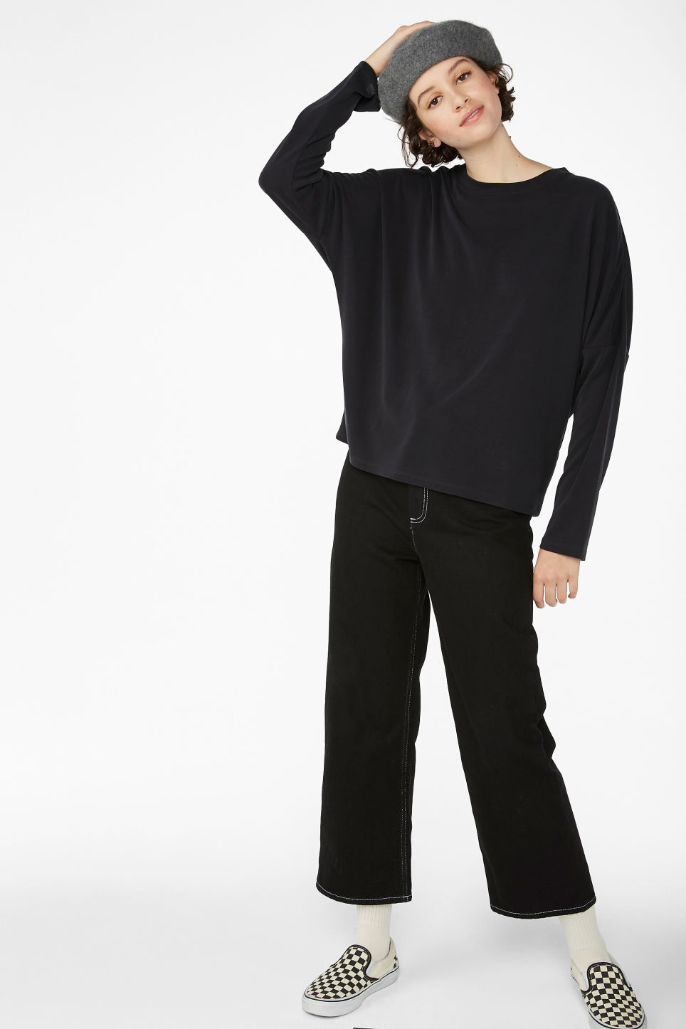 Model side image of Monki super-soft flowy top in black