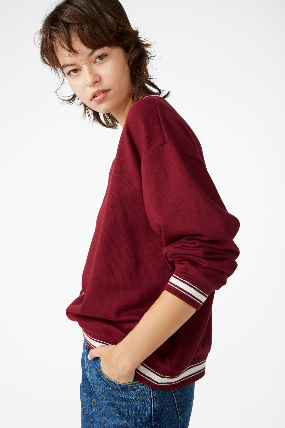 Model front image of Monki loose-fit sweater in red