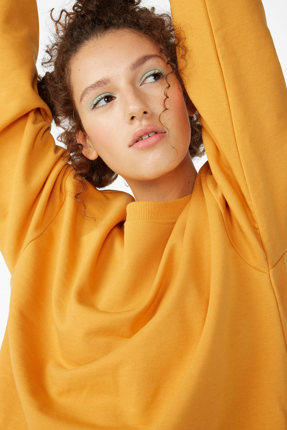 Model front image of Monki loose-fit sweater in yellow