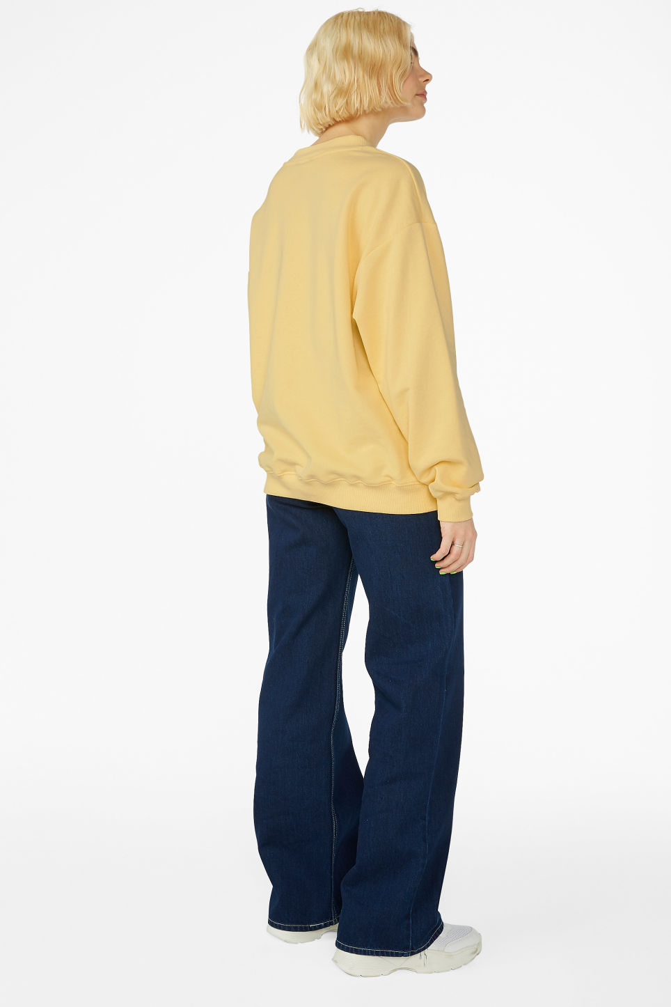Model back image of Monki loose-fit sweater in yellow