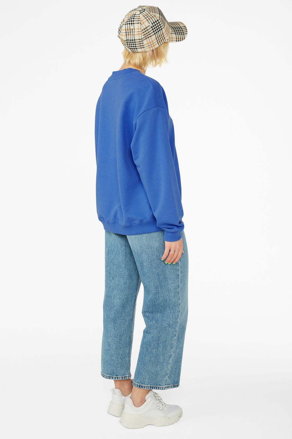 Model back image of Monki loose-fit sweater in blue