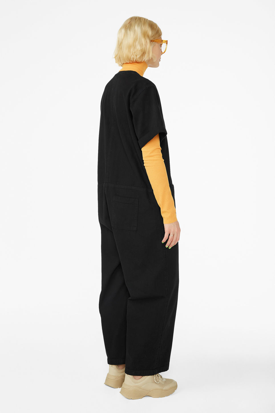 Model back image of Monki denim boilersuit in black