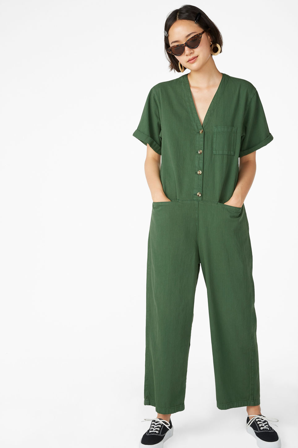 Model front image of Monki v-neck denim jumpsuit in green