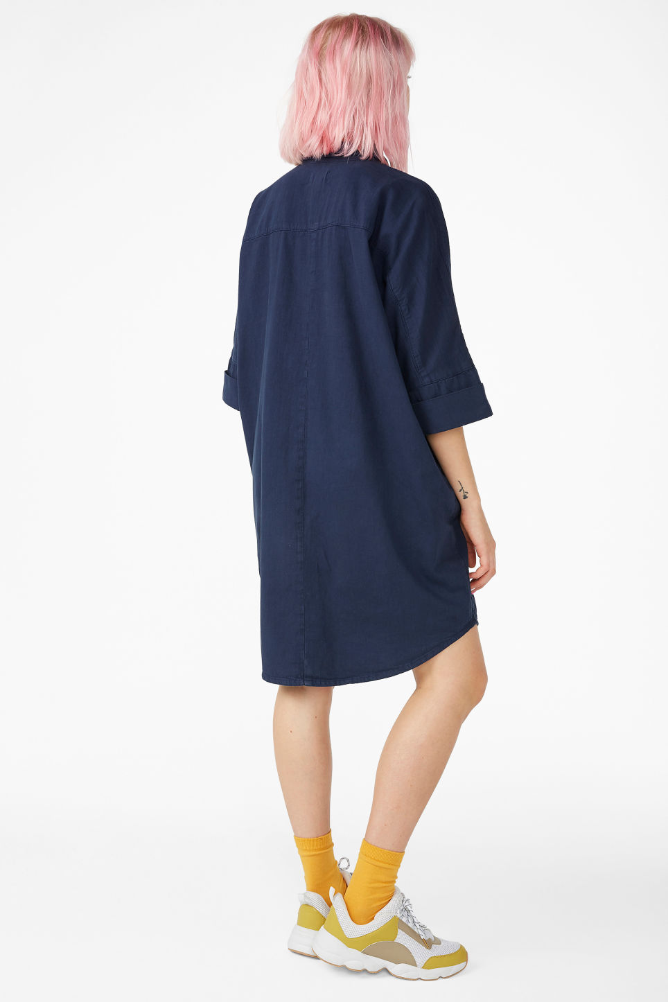 Model back image of Monki hidden button shirt dress in blue