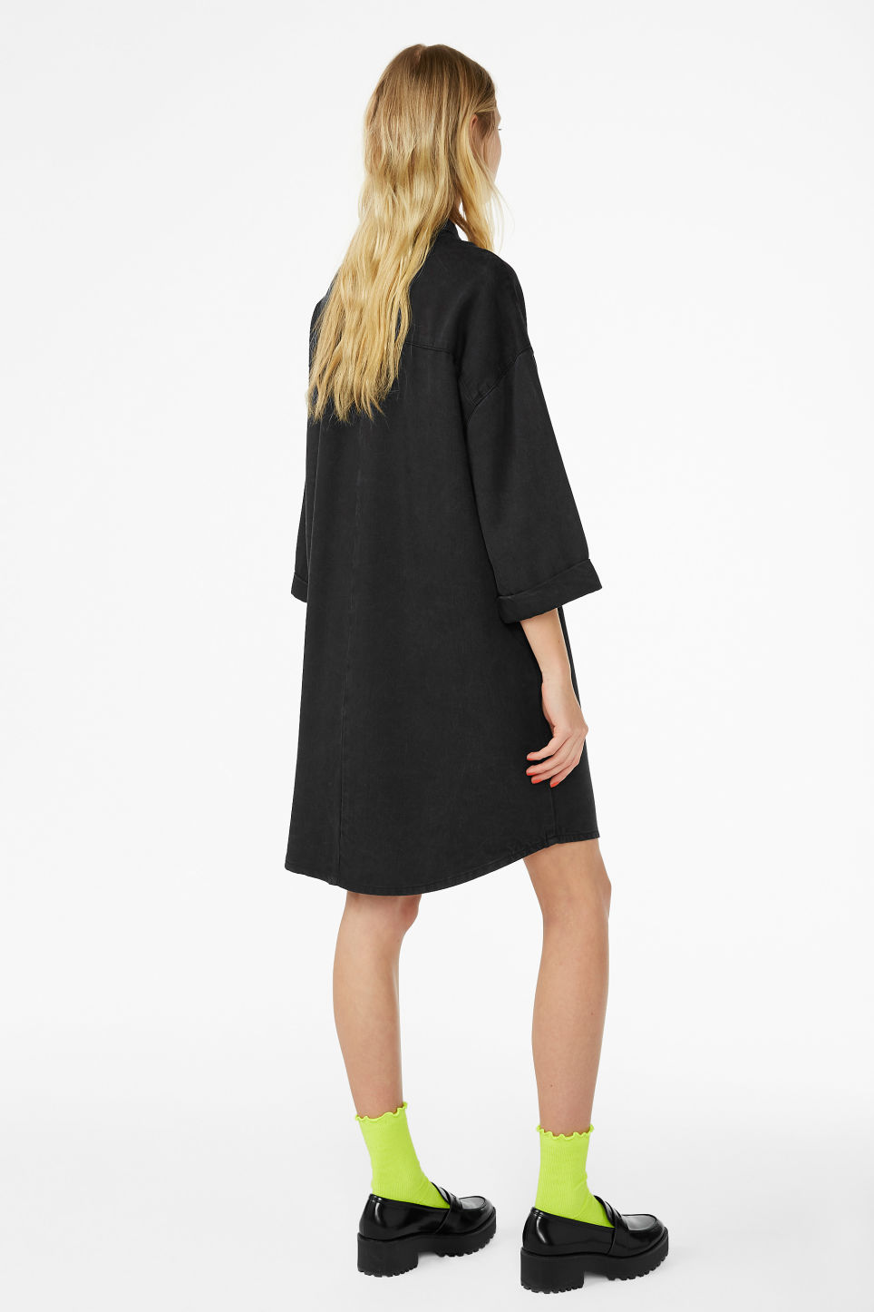 Model back image of Monki hidden button shirt dress in black