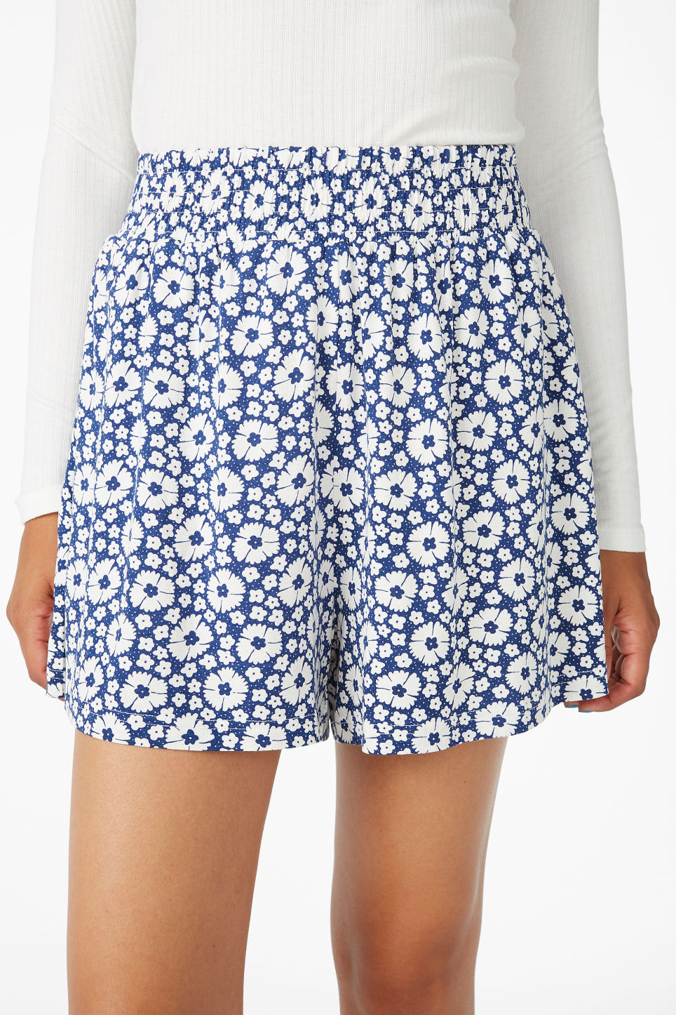 Model side image of Monki flowy shorts in blue