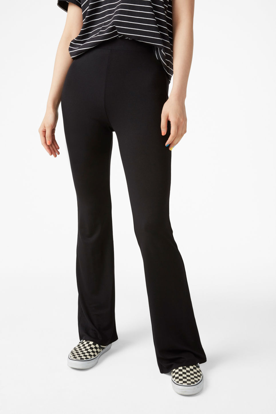Model side image of Monki stretchy trousers in black