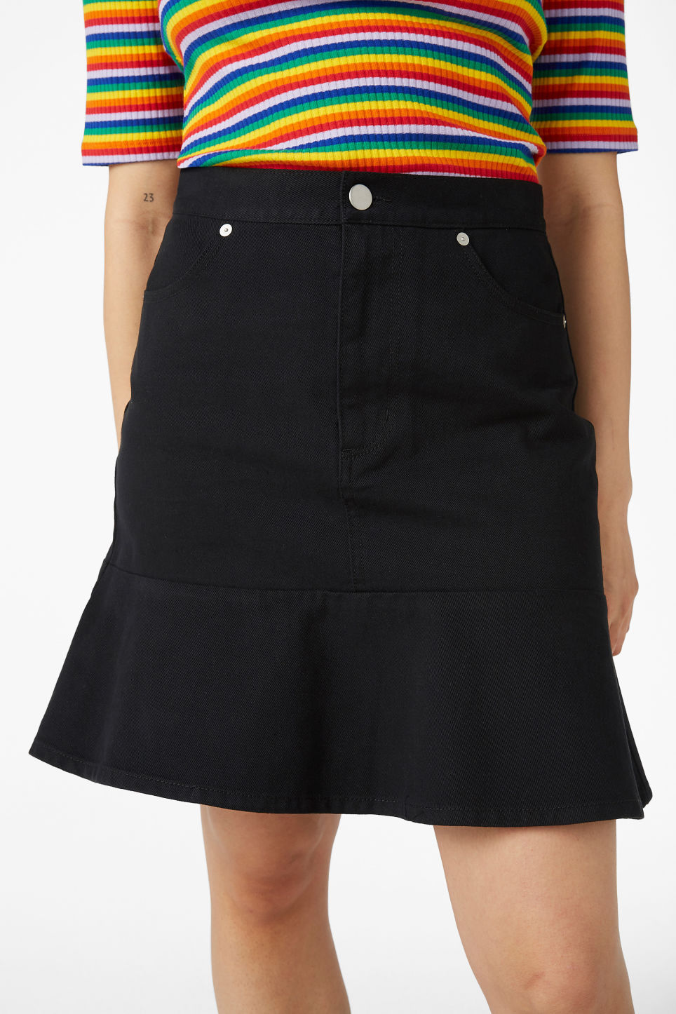 Model side image of Monki denim frill skirt in black