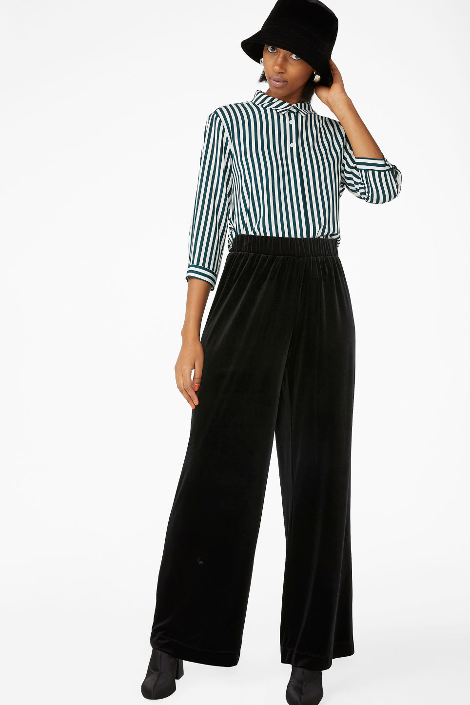Model front image of Monki flowy velvet trousers in black