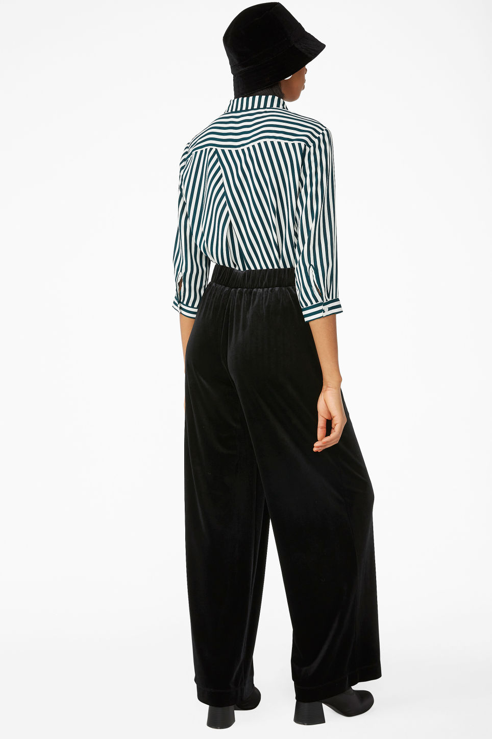 Model back image of Monki flowy velvet trousers in black