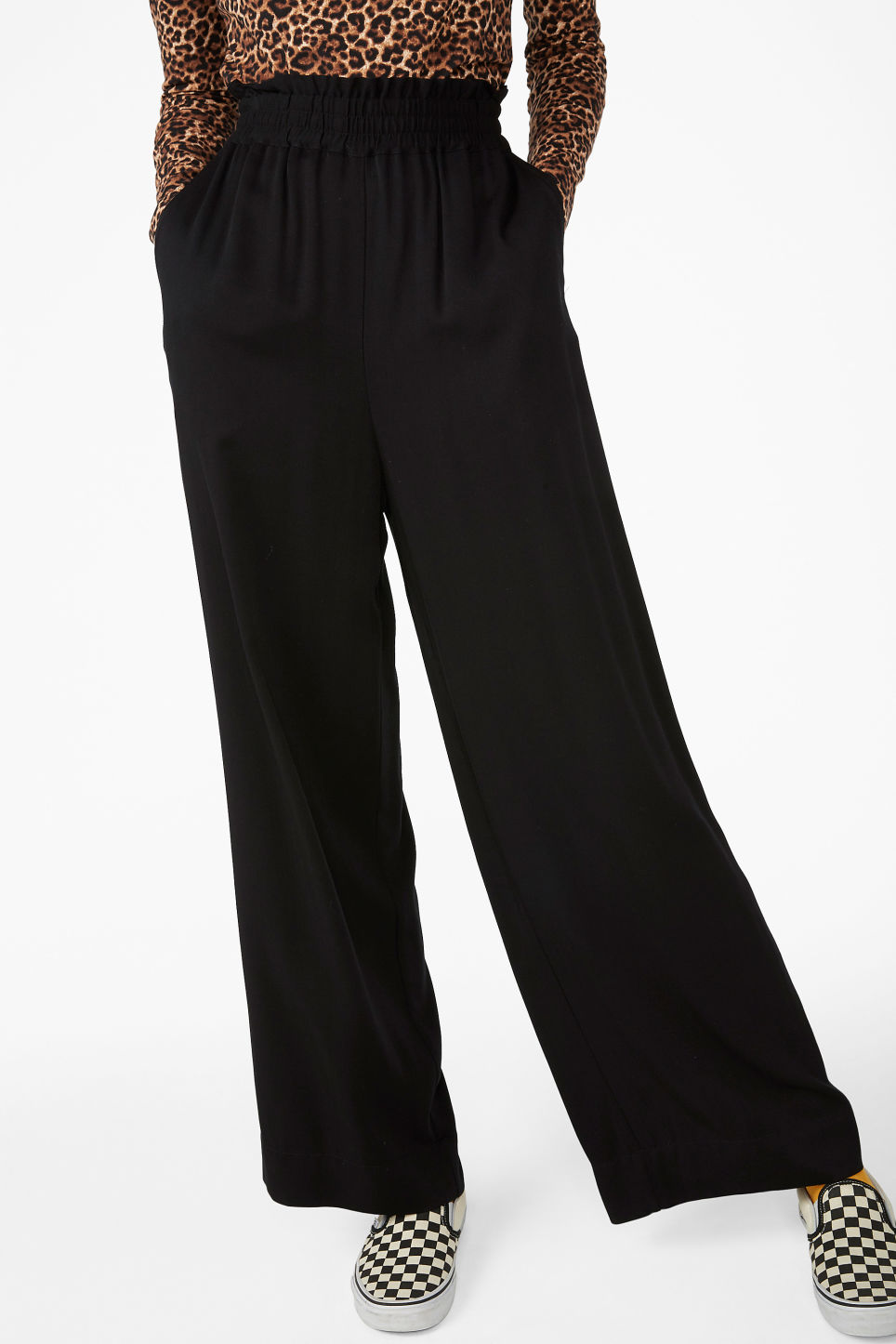 Model side image of Monki luxe viscose trousers in black