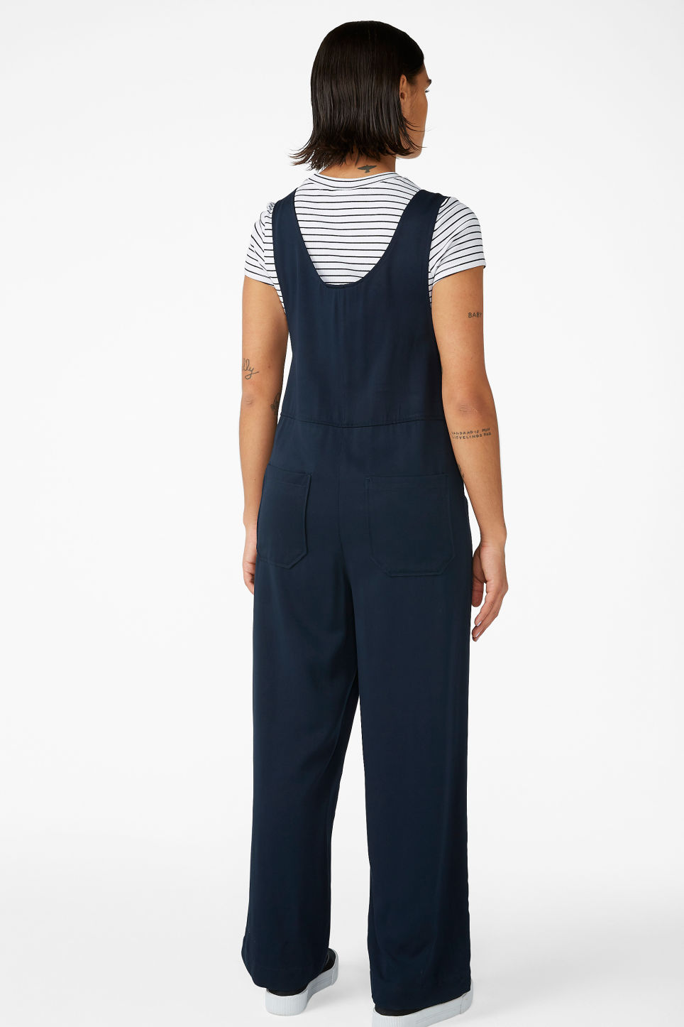 Model back image of Monki minimalistic jumpsuit in blue