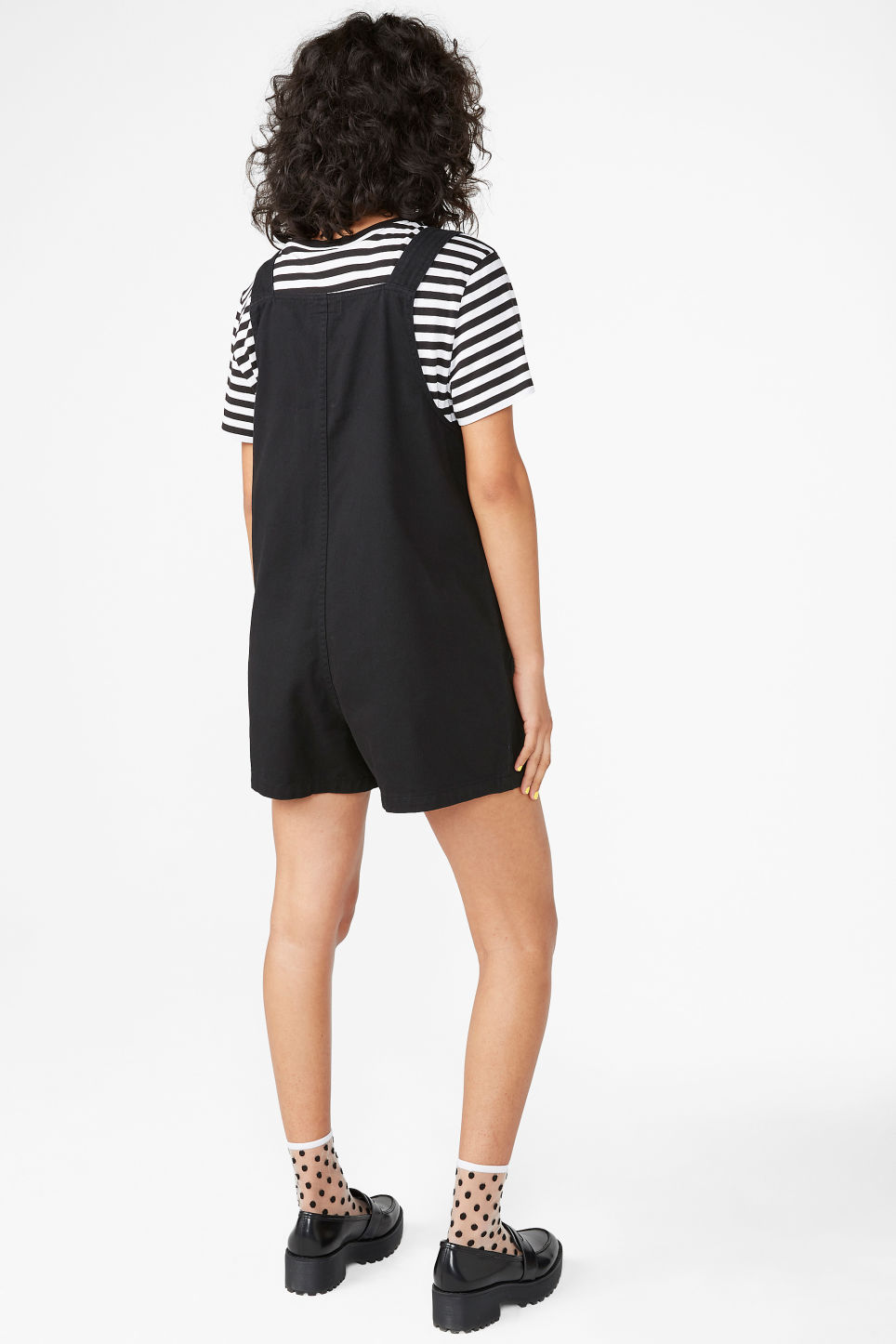 Model back image of Monki dungaree playsuit in black