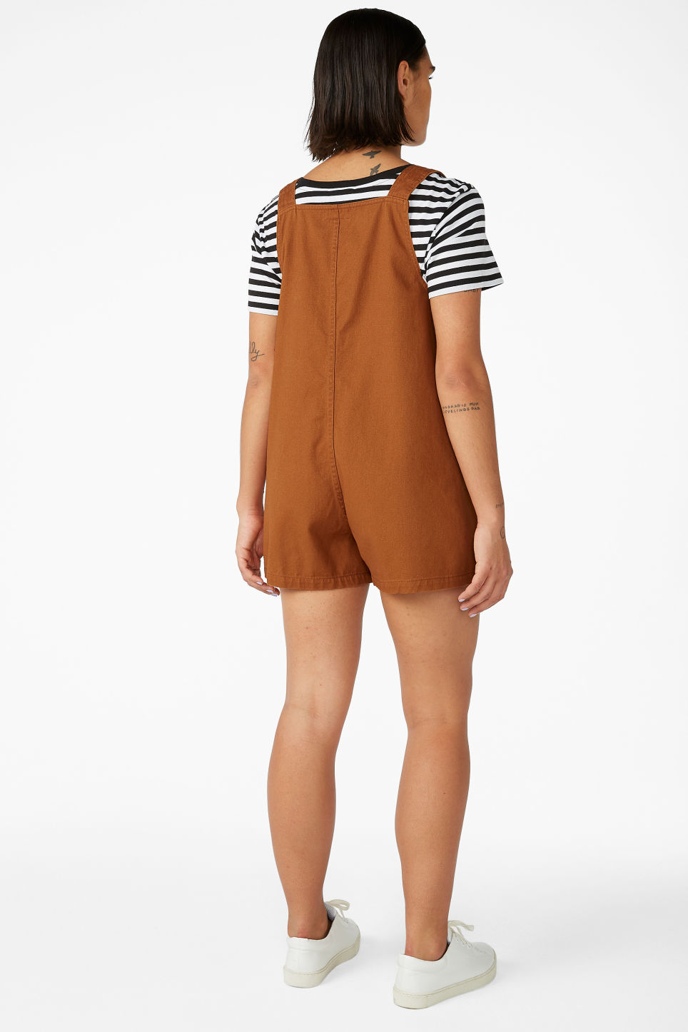 Model back image of Monki dungaree playsuit in orange
