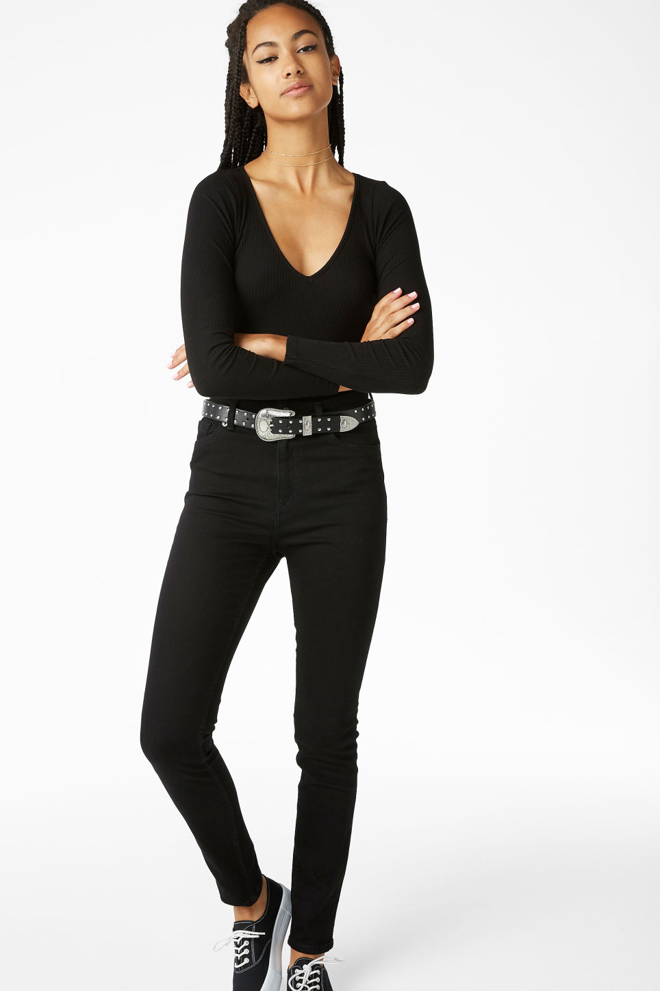 Model side image of Monki ribbed long-sleeved body in black