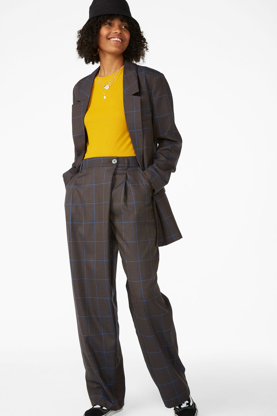 Model front image of Monki checked trousers in grey